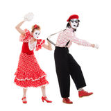 Portrait of mimes. angry woman beating man Stock Photography