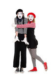Portrait of mimes. happy woman embracing man Royalty Free Stock Photo