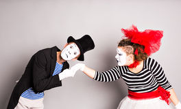 Portrait of mimes in love. man kissing womans hand stock photography