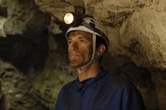 Portrait of a miner inside a mine. A portrait of a miner inside a mine royalty free stock images