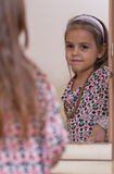 Portrait in the mirror. Portrait of little girl. Reflection in the mirror Royalty Free Stock Photography