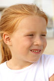 Portrait of a mischievous red-haired girls 5 years Royalty Free Stock Images