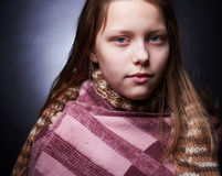 Portrait of a miserable little girl Stock Photography