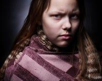 Portrait of a miserable little girl Stock Image