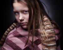 Portrait of a miserable little girl Stock Photo