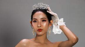 Miss Pageant Beauty Contest in white gray sequin. Portrait of Miss Pageant Beauty Contest in white gray sequin Evening Ball Gown dress sparkle light Silver Dond royalty free stock photography