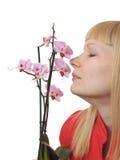 Portrait mit Orchidee Stockfotografie
