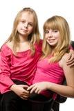 Portrait mit zwei kleinen Schwestern Stockbild
