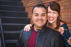 Laughing Mixed Race Caucasian Woman and Hispanic Man royalty free stock image