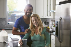 Portrait of mixed race couple in their kitchen Royalty Free Stock Photo