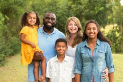Portrait of a multi ethnic family laughing. Portrait of a mixed race family laughing royalty free stock image