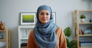 Portrait of mixed race girl in hijab looking at camera with serious face. Portrait of attractive mixed race girl in hijab looking at camera with serious face stock footage