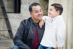 Mixed Race Hispanic Caucasian Son and Father Having a Chatp stock photo