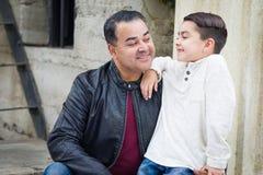 Mixed Race Hispanic Caucasian Son and Father Having a Chatp. Portrait of Mixed Race Hispanic and Caucasian Son and Father stock photo