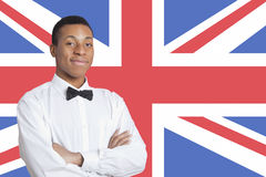 Portrait of mixed race man against British flag Stock Image