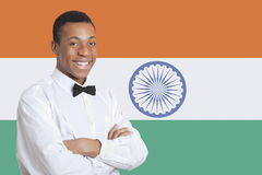 Portrait of mixed race man against Indian flag Stock Images