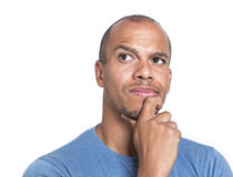 Portrait of a mixed race man concentrating and thinking to himself Royalty Free Stock Photo