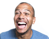 Portrait of a mixed race man laughing hysterically. Mixed race man is laughing loudly at something Stock Photography
