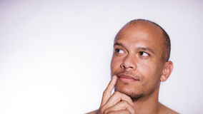 Portrait of a mixed race man thinking with space for text Stock Photography