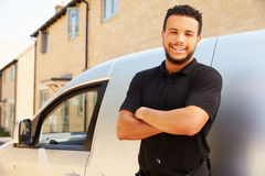 Portrait of mixed race tradesman by a van Stock Photography