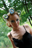 Portrait of Model with curlers. A young Model posing with curlers Stock Photography