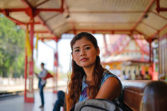 Portrait of model sitting at Hua Hin train station. Royalty Free Stock Image