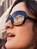 Portrait of a model with Trevi's fountain reflected on sunglasse. S Royalty Free Stock Image