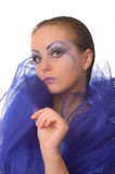 Portrait of a model with an unusual make-up. In a blue cape Stock Image
