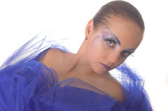 Portrait of a model with an unusual make-up. In a blue cape Stock Photo