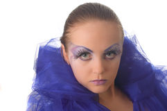 Portrait of a model with an unusual make-up. In a blue cape Royalty Free Stock Photo