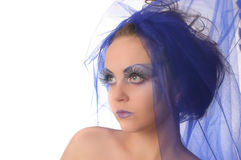 Portrait of a model with an unusual makeup. Portrait of a model with an unusual theatrical makeup in a blue headdress Stock Photography