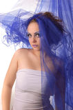 Portrait of a model with an unusual makeup. Portrait of a model with an unusual theatrical makeup in a blue headdress Royalty Free Stock Photo