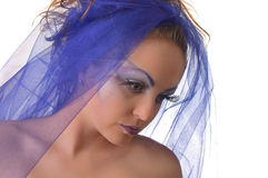 Portrait of a model with an unusual makeup. Portrait of a model with an unusual theatrical makeup in a blue headdress Royalty Free Stock Images
