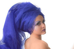 Portrait of a model with an unusual makeup. Portrait of a model with an unusual theatrical makeup in a blue headdress Stock Photos