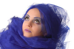 Portrait of a model with an unusual makeup. Portrait of a model with an unusual theatrical makeup in a blue headdress Royalty Free Stock Photos