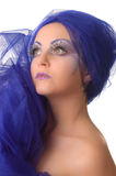 Portrait of a model with an unusual makeup. Portrait of a model with an unusual theatrical makeup in a blue headdress Royalty Free Stock Photography