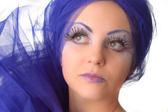 Portrait of a model with an unusual makeup. Portrait of a model with an unusual theatrical makeup in a blue headdress Royalty Free Stock Image