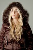 Portrait of model wearing hood jacket Stock Photo