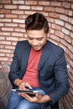 Modern Asian Man Using Digital Tablet in Office stock photography