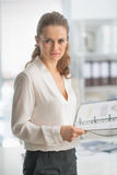Portrait of modern business woman with documents Stock Photo
