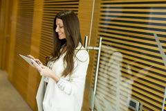 Portrait of modern business woman holding tablet in her hands Stock Photos