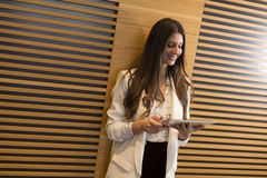 Portrait of modern business woman holding tablet in her hands Royalty Free Stock Photos