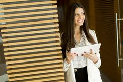 Portrait of modern business woman holding tablet in her hands Stock Image