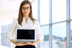 Portrait of modern business woman  working with laptop computer in the office, copy space area. Portrait of modern business woman working with laptop computer in Royalty Free Stock Photos