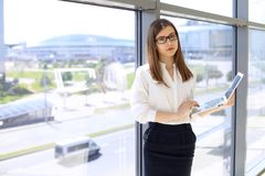 Portrait of modern business woman working with laptop computer in the office, copy space area royalty free stock photo