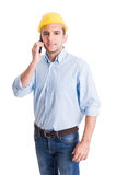 Portrait of a modern engineer talking on smartphone Royalty Free Stock Images