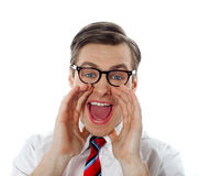 Portrait of a modern excited businessman. Excited businessman shouting in joy, closeup shot Stock Images