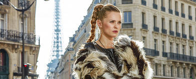 Portrait of modern fashion-monger in fur coat in Paris, France Stock Photography
