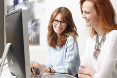 Portrait of modern graphic designer woman. Modern graphic designer women working with colleagues in office. Small business Royalty Free Stock Images