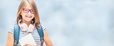 Portrait of modern happy teen school girl with bag backpackand o royalty free stock image